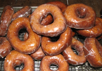 Lots of glazed doughnuts